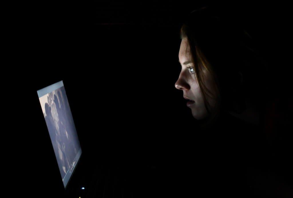 Watching computer at night