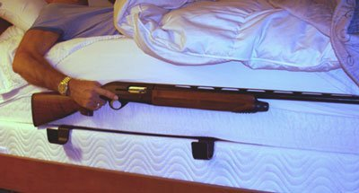 Sleepwalking gun in bed