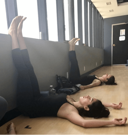 a yoga instructor illustrates the best poses for sleep